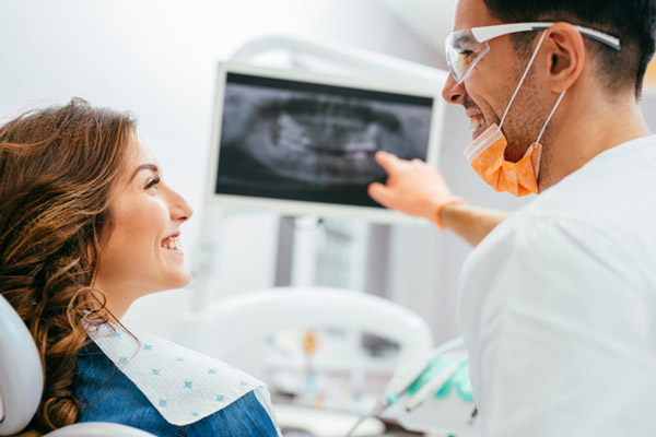 Dentist explaining an xray to a woman patient